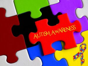 Jigsaw puzzle showing the words autism awareness